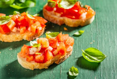 Classic italian bruschetta served on wooden board