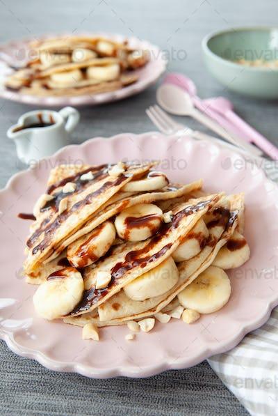 Pancakes with banana and chocolate sauce