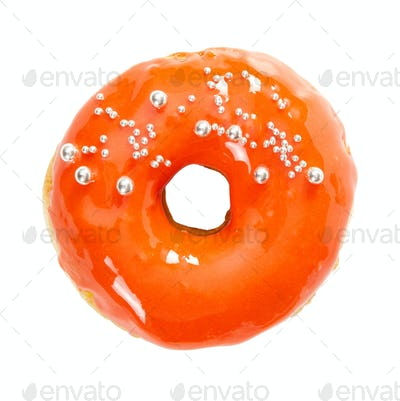 Donut with yellow glossy mirror glaze isolated on white