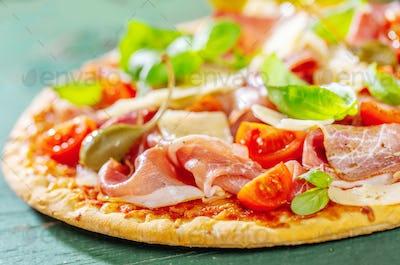 Appetizing italian pizza with prosciutto