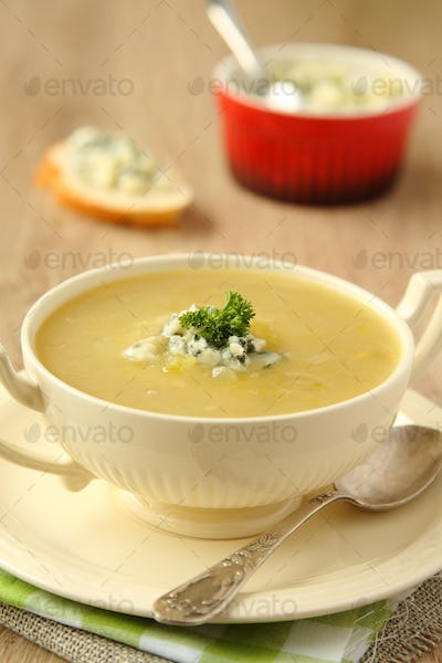 Homemade onion soup with celery and blue cheese