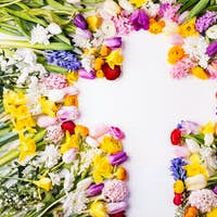 Flowers and cross Easter abstract concept on a white background. Copy space.