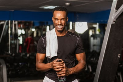 Black African American  young man doing  workout at the gym