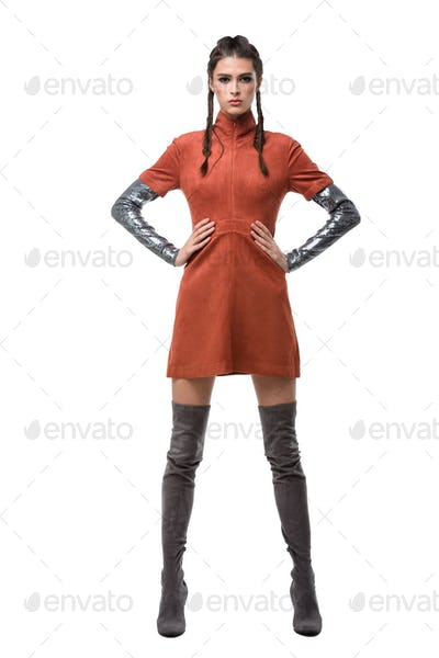Young beautiful lady standing in light brown dress and knee high boots on white background