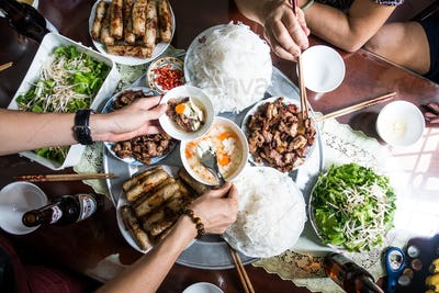 Feasting with family on Vietnamese traditional food