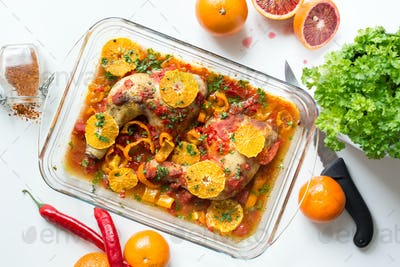 Roasted chicken with blood oranges and herbs