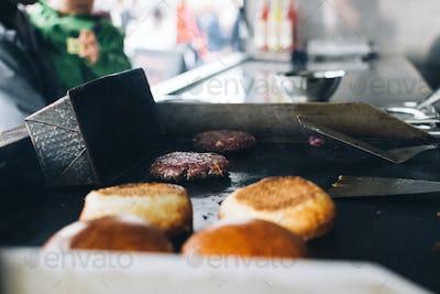 Preparation of burger in food truck