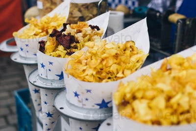 Cornets of fried chips at market