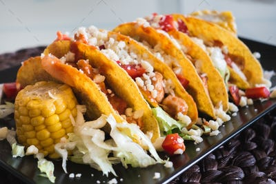 Homemade chicken tacos with corn and cheese