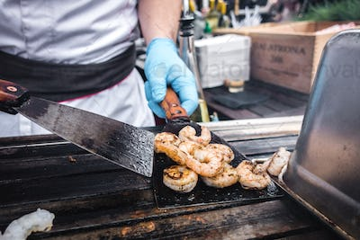 Grilling prawns at street food market