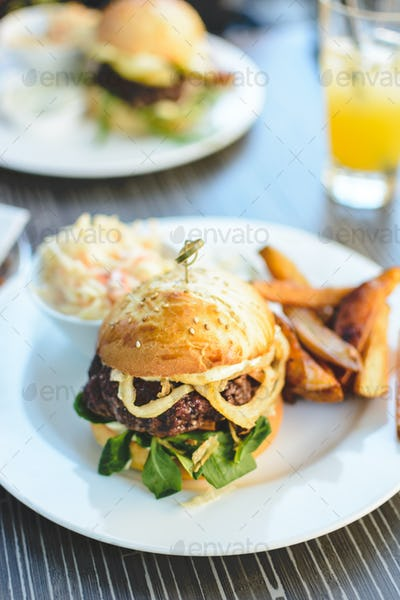 Juicy beef burger with baked potatoes