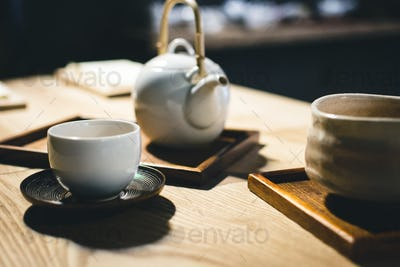 Tea cup with freshly brewed green tea