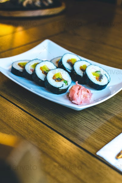 Traditional Korean Gimbap rice rolls with fermented vegetables