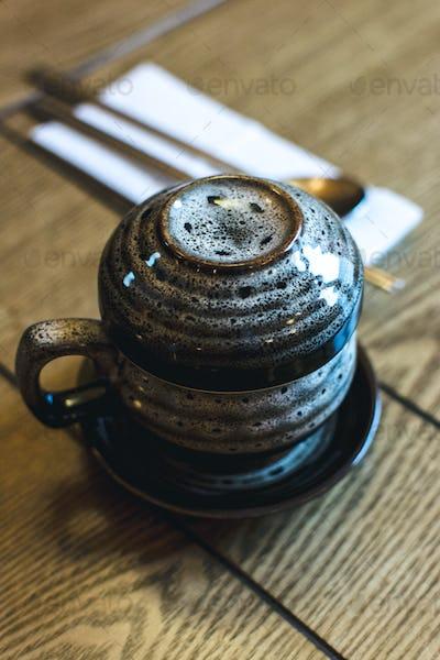 Tratidional Korean tea pot on a wooden table