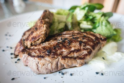 Grilled beef steak with garden side salad
