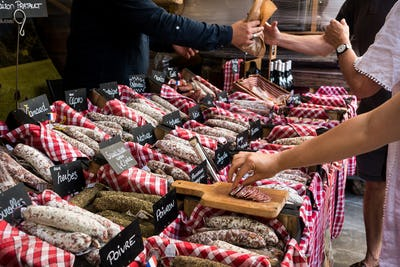 Tasting dried fuet salami at French market