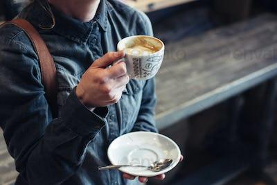 Enjoying cup of flat white
