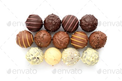 Top view of various chocolate pralines isolated on white backgro