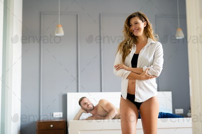 Sexy young couple in bedroom foreplay concept