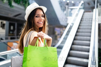 Happy woman with shopping bags enjoying in shopping