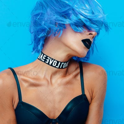Girl with blue hair and bright stylish party make up.  Sexy blue
