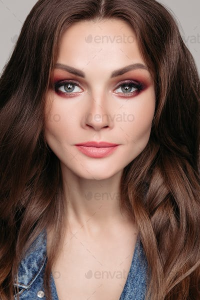 Beautiful brunette woman with bright make up