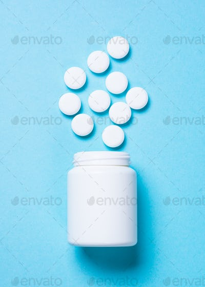Pills on blue top view
