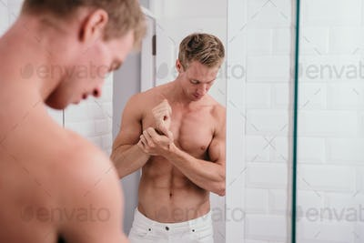 Handsome athletic men shirtless at front reflection the mirror