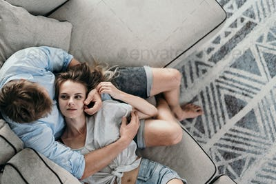 couple bonding and smiling while lying