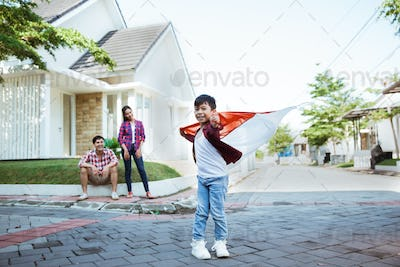 kid holding flag celebrating independence day