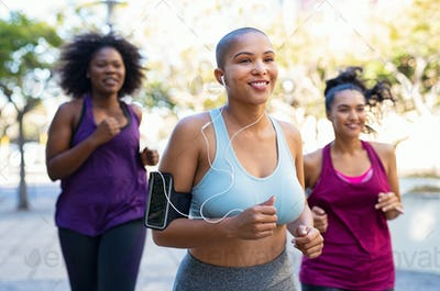 Group of natural curvy women jogging