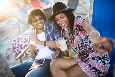 African american man and woman flirting talking at bar counter