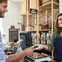 Customer Making Contactless Payment For Shopping At Checkout Of Grocery Store