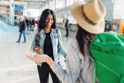 Female tourists with bags in international airport