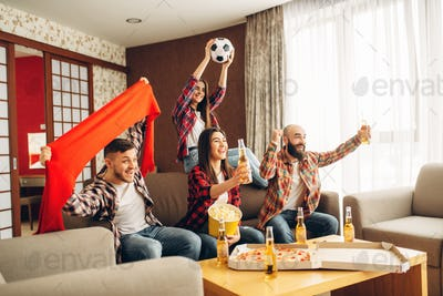 Friends cheer for favorite team, football fans