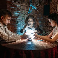 Foreteller calls the spirits over a crystal ball