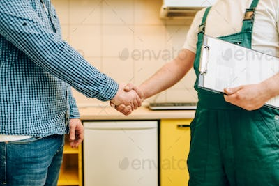Repairman and customer shake hands, handyman