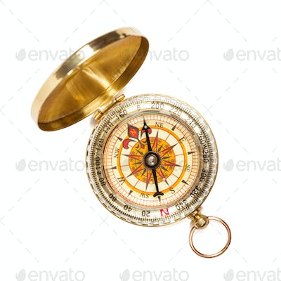 Vintage golden compass isolated