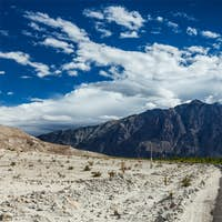 Road in Himalayas with cars