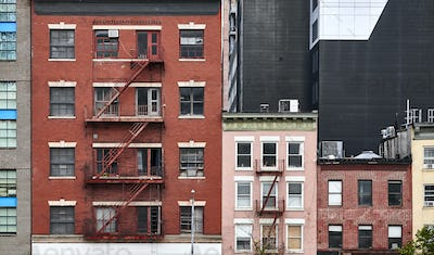 Old tenement houses with fire escapes in New York.