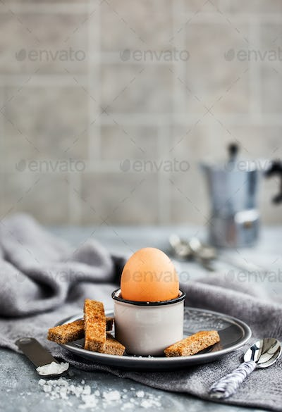 Boiled egg with rye toasts for breakfast