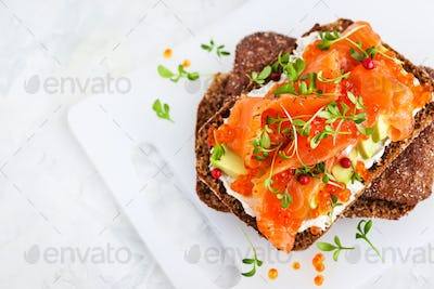 Salted salmon, red caviar, avocado and cream cheese rye crisp to