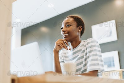Casual woman working in cafe