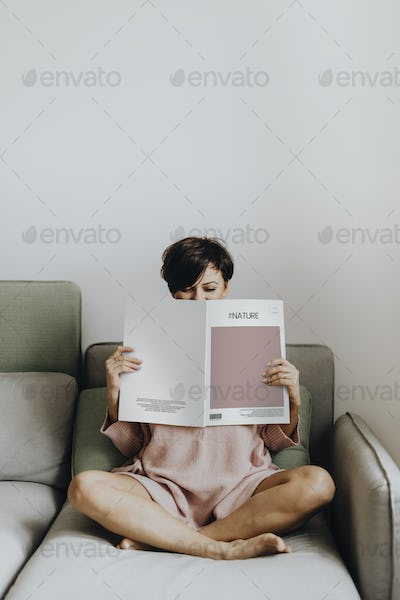 Woman reading a design magazine
