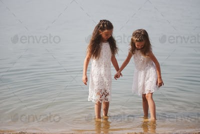 cute happy little girls in sumer lake