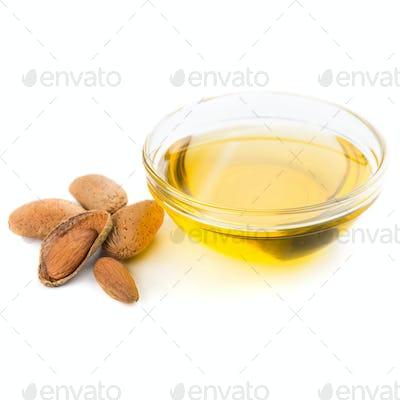 Almond oil in bowl on white