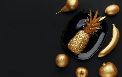 Golden fruits on plate
