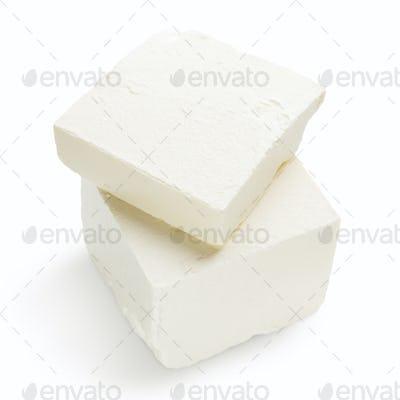Pieces of Feta cheese on white