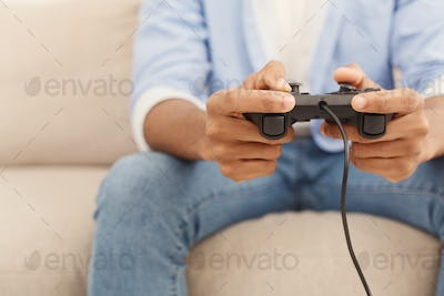 Young man playing video games at home