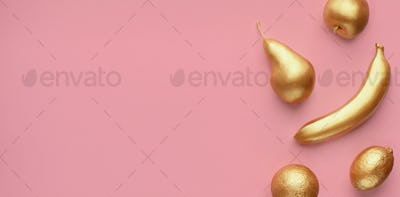 Golden fruits collage on pink